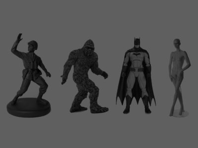 Four plastic figures: a toy soldier, big foot, batman, and a bald naked female mannequin