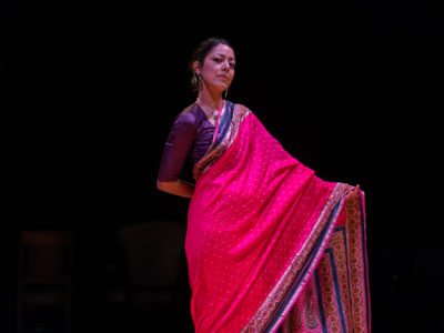 An actress in the spotlight wearing an Indian sari