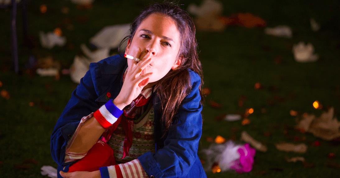 Susannah Millonzi: an actress on stage smoking an e-cigarette