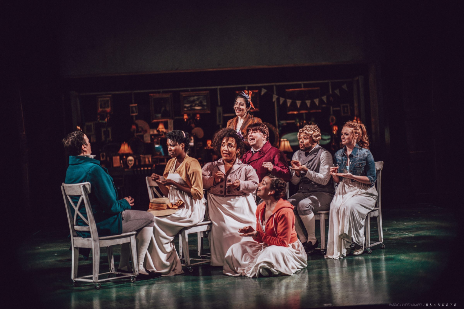 The cast of Bedlam's SENSE & SENSIBILITY sitting on chairs on stage
