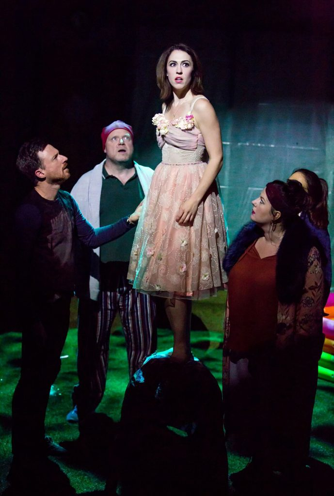 Bedlam Theatre Peter Pan Scene: 5 actors with a spot light on them with the central woman standing on a mound (or someones back) while looking suprised