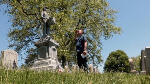 Man saluting at veterans cementary